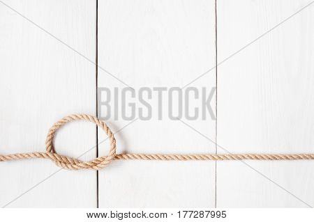Rope on the white aged wooden boards
