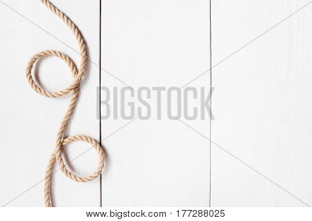 Twisted Rope On The White Wooden Background