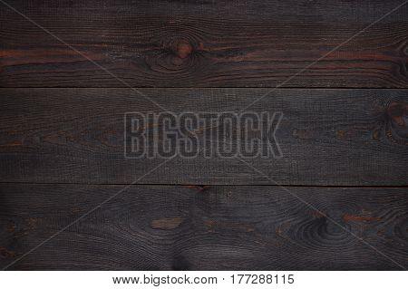 Dark aged brown wooden textured background, old boards