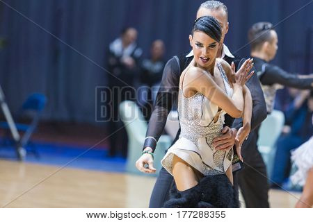 Minsk Belarus-February 19 2017: Professional Dance Couple of Kuzin Evgeny and Fedoseeva Anastasia Performs Adults Latin-American Program on WDSF Minsk Open Dance Festival-2017 on February 19 2017 in Minsk Belarus.