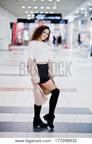 Young Curly Model Girl Posed On Mini Skirt At Large Shopping Center.