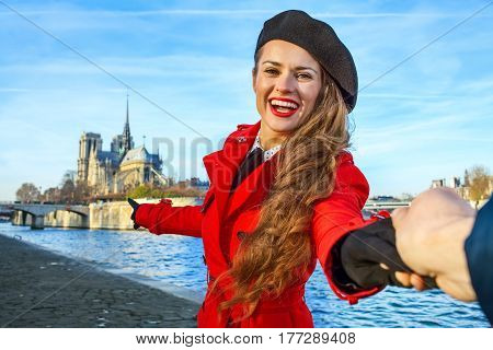 Traveller Woman Holding Friends Hand And Pointing At Notre Dame De Paris