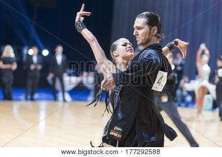 Minsk Belarus-February 19 2017: Professional Dance Couple of Gerasimov Svyatoslav and Zakharchuk Anastasia Performs Adults Latin-American Program on WDSF Minsk Open Dance Festival-2017 on February 19 2017 in Minsk Belarus.