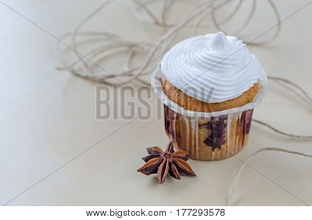 Cake With Cream On Wooden Board