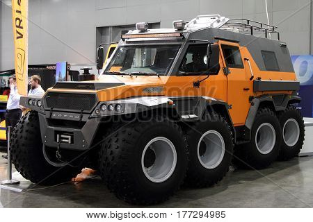 MOSCOW - MARCH 09 2017: Russian Shaman an all-terrain vehicle with the wheel formula 8x8 for 10 International boat show in Moscow. Russia.