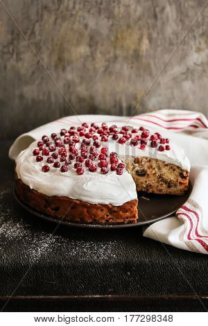 Easter cake with dried fruits decorated with meringue and fresh cranberry, selective focus