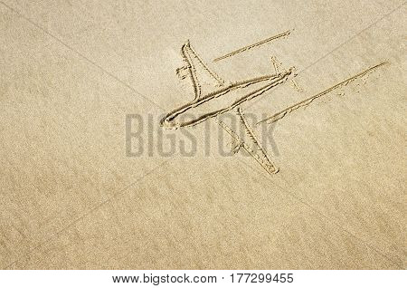 Drawing of an airplane in the sand on the beach.