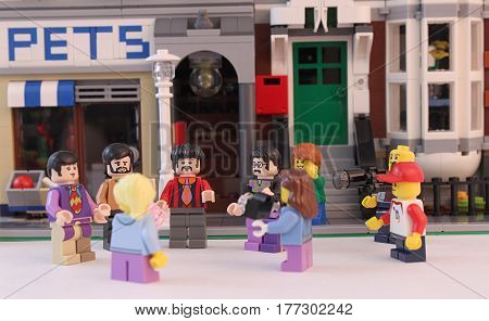 Colorado, USA - March 20, 2017: Studio shot of Lego minifigure Beatles standing together on a street in front of a building.