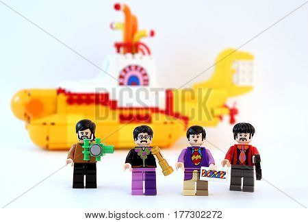 Colorado, USA - March 20, 2017: Studio shot of Lego minifigure Beatles with yellow submarine in the background.