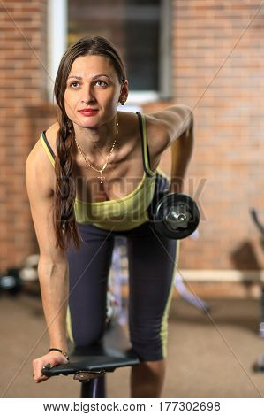 Fitness And Physical Exercises. Young Beautiful White Girl In A Yellow And Gray Sports Suit Is Train