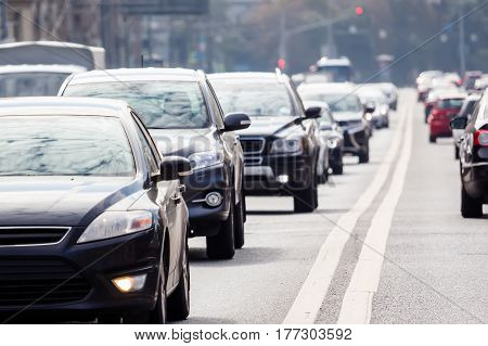 Zoom view of the road with grey cars in the rush hour