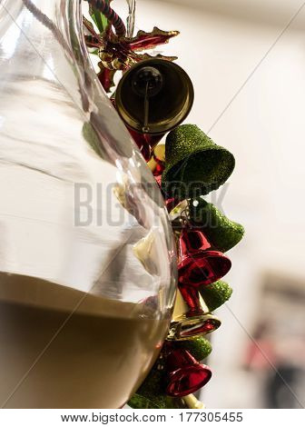 jingle bells at christmas time on the side of glass vase