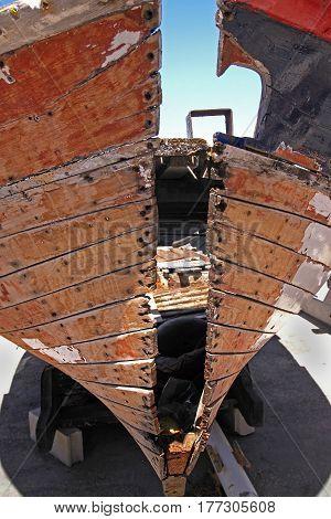 Old destroyed wooden colored fishing boat under repair. Saint Tropez Cote d'Azur France. June 22 2016