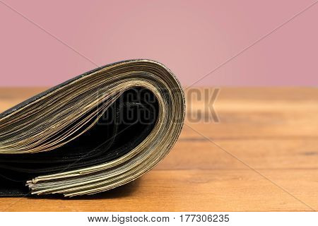 Stack of US twenty dollar bills stashed in wallet to illustrate cash or shadow economy