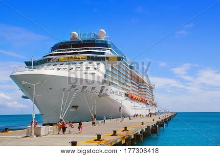 PHILISBURG, ST. MARTEEN - APRIL 16,2015:  Cruise ship Celebrity Silhouette, docked at Philisburg, St. Marteen harbor on a clear sunny day.