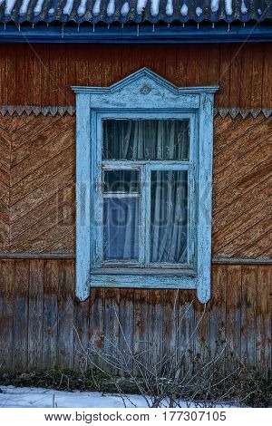 Wooden window on an old house wall