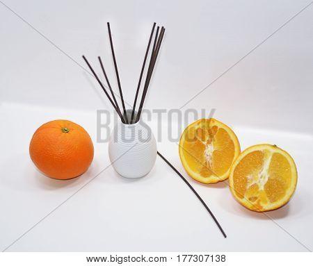 Aromatic Sticks For Home In White Ceramic Vase.