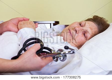 Picture of an elderly woman having a serious influenza