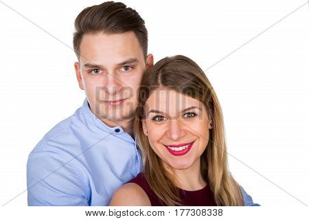 Young cute couple posing on an isolated background