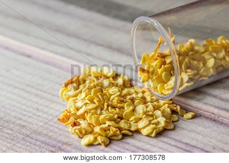 Seeds Scattered From A Jar On A Gray Board Lie Slide