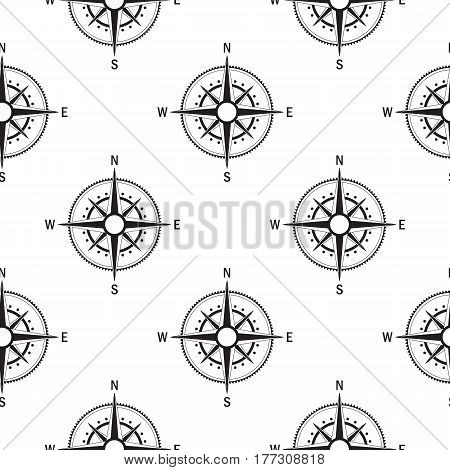 Seamless pattern with the image of vintage compass on white background isolated. The device allows to determine the direction of the world.