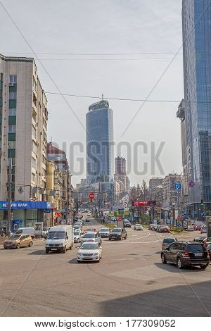 KIEV, UKRAINE - MARCH 24, 2014: Mid-day in the center of Kiev in the Baseina street with a view to the City Commerce Bank skyscraper.
