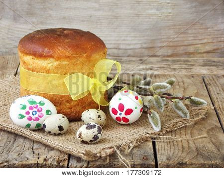 Easter Composition Of Sweet Bread, Paska, Willow Twigs And Eggs On Light Wooden Background. Orthodox