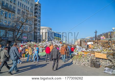 KIEV, UKRAINE - MARCH 22, 2014: People visiting Maidan square and barricades on the Khreshchatyk street and waiting for the Presidential elections.