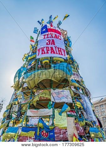 KIEV, UKRAINE - MARCH 22, 2014: Christmas tree on Maidan square covered with messages of support still stands after Revolution.