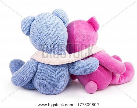Friendship - two teddy bears holding in one's arms