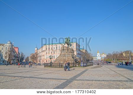 KIEV, UKRAINE - MARCH 22, 2014: People sightseeing The Khmelnytsky Monument. Statue was installed in 1888 at Sofia square.