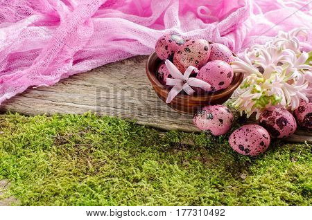 Easter Background With Colorful Eggs And Flowers On Green Moss Background.