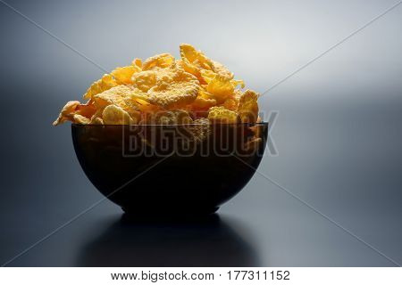 cornflakes in a dish illuminated from above