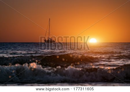 Boat and sunset in sea
