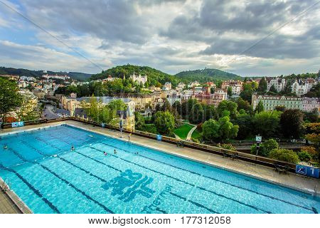 Karlovy Vary, Czech Republic - September 13, 2013: Outdoor swimming poll in the Thermal Hotel in Karlovy Vary, Czech Republic.