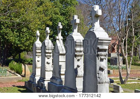 ATLANTA, GA - MAR  17, 2017 Five matching headstones line up beautifully at the Oakland Cemetery.