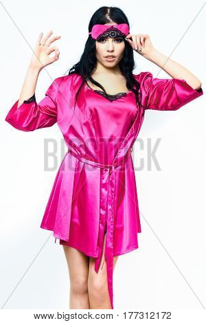 Sexy Girl Posing In Pink Silk Robe Isolated On White