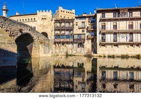 Reflection In The River In Valderrobres, Spain