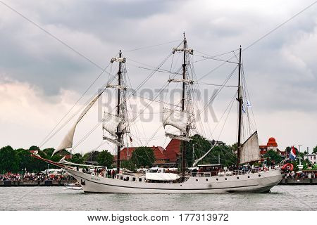 Rostock, Germany - August 2016: Sailing ship Artemis on the baltic sea. Hanse-Sail Warnemuende at port Rostock, Mecklenburg-Vorpommern, Germany. Tall Ship.Yachting and Sailing travel. Cruises and holidays