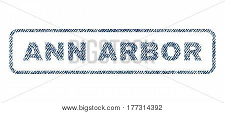Ann Arbor text textile seal stamp watermark. Blue jeans fabric vectorized texture. Vector caption inside rounded rectangular banner. Rubber emblem with fiber textile structure.