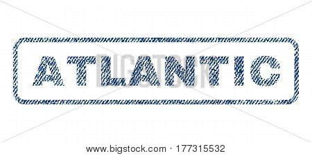 Atlantic text textile seal stamp watermark. Blue jeans fabric vectorized texture. Vector caption inside rounded rectangular banner. Rubber sticker with fiber textile structure.