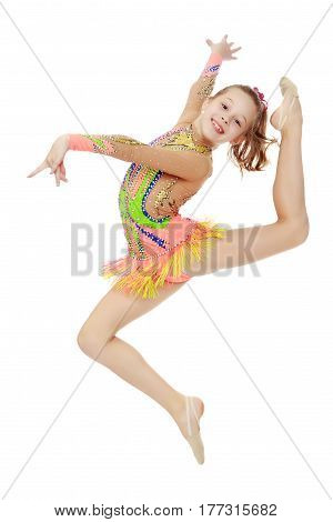 Beautiful little girl gymnast dressed in sports swimsuit for competitions, performs a jump.Isolated on white background.