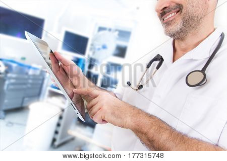 Doctor with stethoscope and tablet in a hospital, close-up.