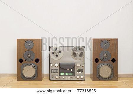 vintage analog magnet tape recorder, big wooden speakers