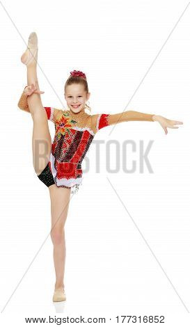 Beautiful little girl gymnast dressed in sports suits for competitions, standing on one leg.Isolated on white background.