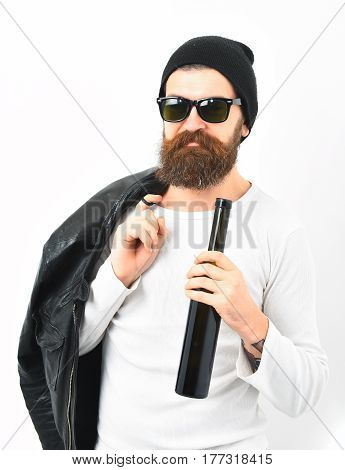 Bearded Brutal Caucasian Hipster Holding Bottle