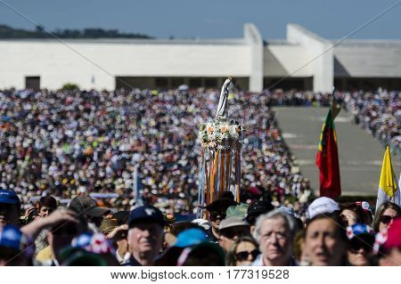 Fatima Portugal - May 13 2014: The statue of the Virgin Mary of Fatima being carried among the crowd of people at the Sanctuary of Fatima during the celebrations of the apparition of the Virgin Mary in Fatima Portugal.