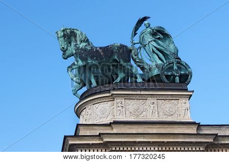 BUDAPEST, HUNGARY - AUGUST 08, 2012: Millennium Monument on the Heroes' Square in Budapest Hungary. Bronze sculpture of Chariot of the War.