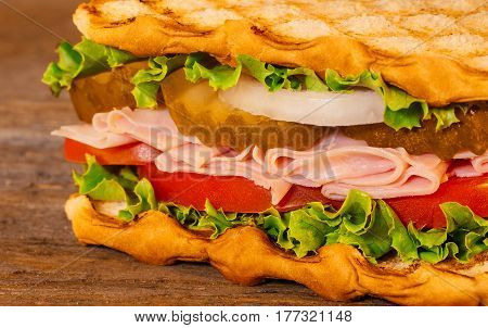 Closeup Sandwich With Ham,cheese And Fresh Vegetables