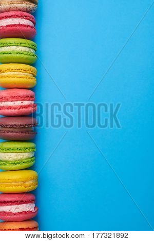 Side stack of exquisite macaroons with a place for a copy space. Stretch of french colorful macaroons